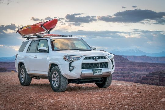 Toyota 4runner SUV with a kayak on roof on a canyon trail