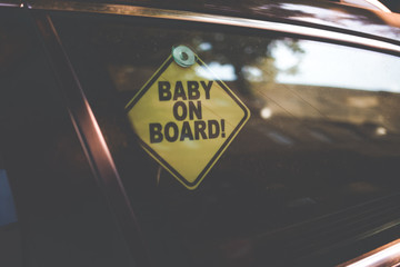 sign baby on board. warning about a child in the car. baby sign in car