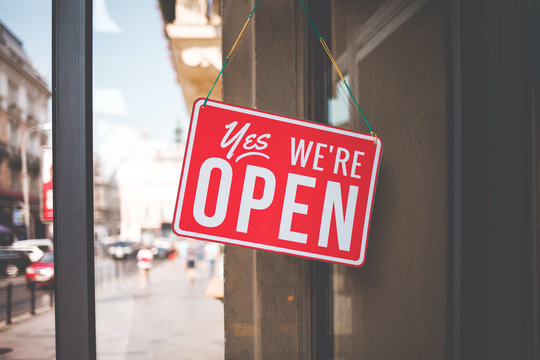 yes we're open sign on the glass of the doors in store.  welcome sign at the store