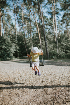 Girl on swing on playground