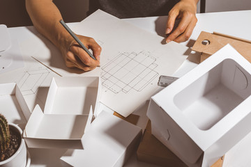 The designer creates a mockup for crafting of cardboard ecological packaging. Development a model...