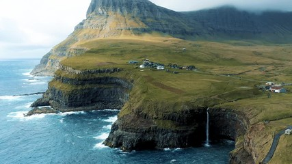 Wall Mural - Aerial view of Gasadalur village and Mulafossur waterfall in the Faroe Islands