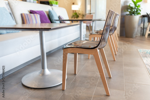 Awesome Modern Clear Acrylic Chair With Wooden Legs At Table Hotel Spiritservingveterans Wood Chair Design Ideas Spiritservingveteransorg
