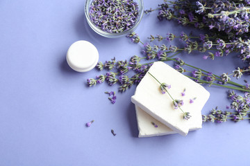 Wall Mural - Flat lay composition with hand made soap bars and lavender flowers on violet background, space for text