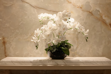 white artificial orchid on a table at indoor