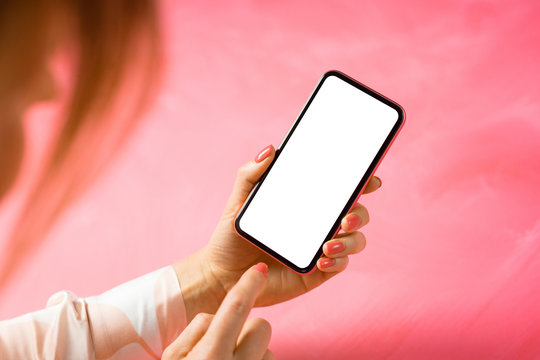 Woman using mobile phone with empty white screen, mockup for your app design.