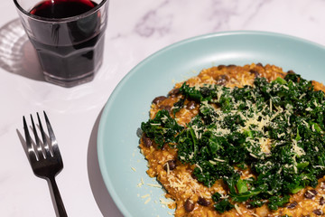 vegetarian black beans risotto with charred kale and vegan cheese topping