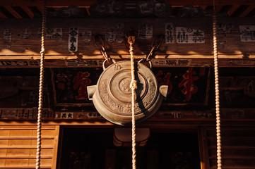 Japanese bronze shinto bell hanging at Shrine. Yamadera, Yamagata - Japan