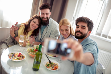 Portrait of a cheerful friends making selfie