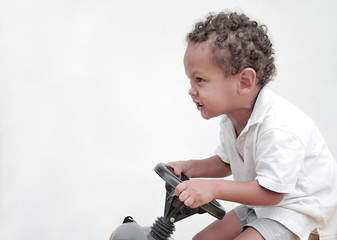 boy riding a toy car with white background stock image stock photo