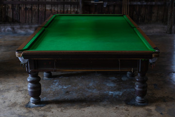 Old billiard, snooker, pool table in rural country classic vintage style