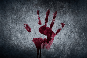 Bloody hand print on the wall