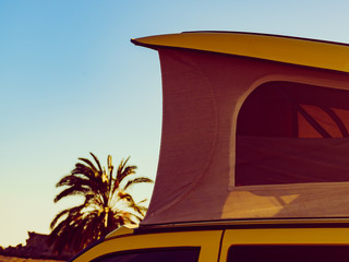 Camper van with tent on roof on beach
