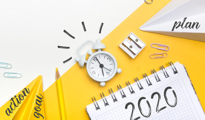new goals for 2020. Composition flat lay. alarm clock on yellow background