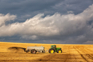 John Deer tractor pulling liquid manure spreader, Germany, Lower Saxony, August 2013