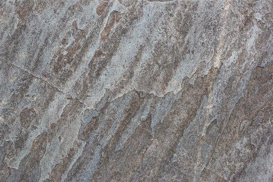 Beautiful old colored sedimentary rock texture closeup