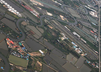 A general view of agricultural land is seen through the window of an airplane of EgyptAir after the rain, over Thailand