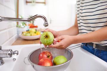 Woman washing seasonal fresh apples