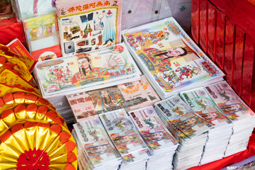 Sara Buri, Thailand - March 16, 2019: Fake Chinese paper money for Qingming festival. Chinese believed that burning fake money will make their ancestor spirits have money to spend in the afterlife.
