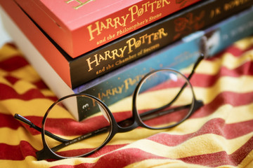 Bangkok, Thailand - July 16, 2019 : Harry Potter books with round shape eyeglasses.