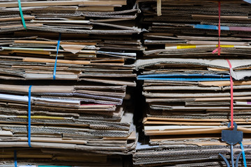 Stack of paper and cardboard waste before shredding at the recycle plant for environment