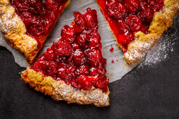 Bakery products. Summer pie with berries. Galeta with cherry sprinkled with powdered sugar. Fototapete