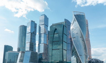 High rise buildings of the business center of Moscow. District Moscow-city against the day sky with clouds