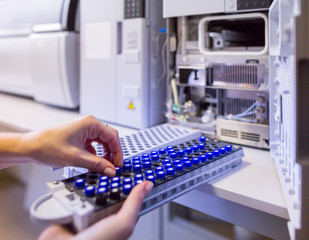 The laboratory scientist prepares samples for download to High-performance Liquid Chromatograph Mass Spectrometr.
