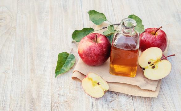 Apple cider vinegar in a bottle. Selective focus.