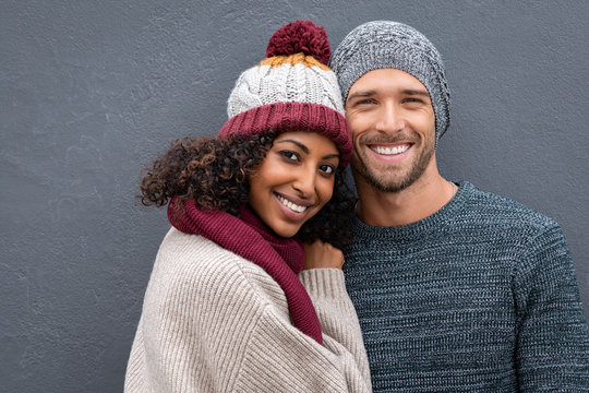 Happy young couple in winter clothes