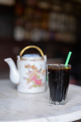 Iced black coffee in the glass Chinese vintage style at Thai Traditional old coffee shop