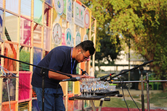 Sajad Mahmood, 23 years old, plays music on wine glasses filled with water, Glass Harp (musical glasses), on the streets of Abu Nawas in Baghdad