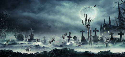Fotobehang - Skeleton Zombie Hand Rising Out Of A GraveYard - Halloween