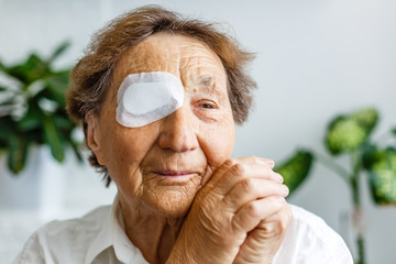 Elderly use eye shield covering after cataract surgery.