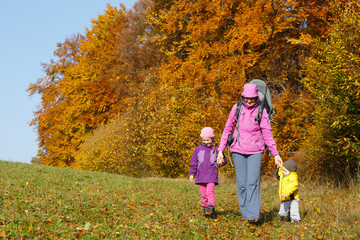 Mother with children hiking on a nice autumn day