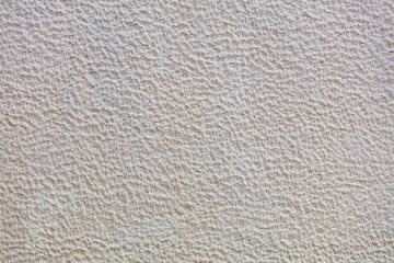 Texture of beige plaster on the wall