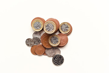 Coins isolated on white British currency representing uk economy and markets