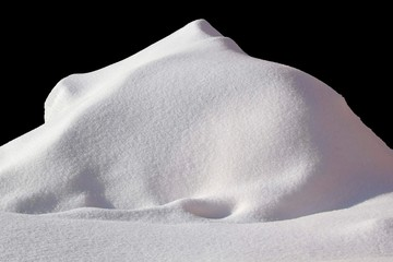Huge Pile of snow isolated on black Wall mural