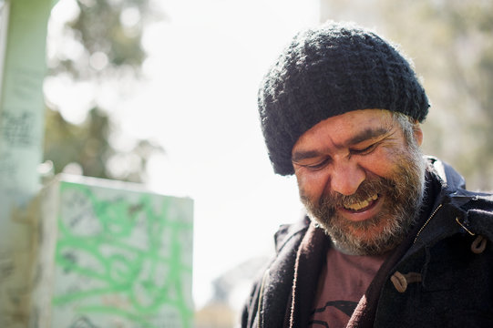 Selective focus of man in beanie