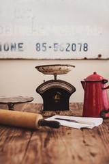 Vintage kitchen items on wooden table