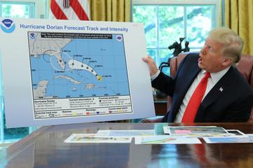 U.S. President Trump receives a Hurricane Dorian update at the White House in Washington