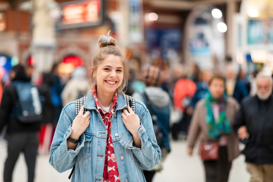 Portrait of happy young woman at the train station