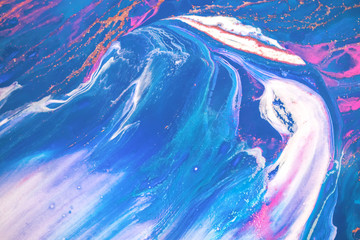 Abstract created using the technique of liquid acrylic. Macro photography of the smallest details of a picture. The picture shows how overflows of shades and colors of paint resemble space motifs. Wall mural