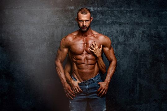 Handsome Muscular Men Posing With Women Hands Around his Torso