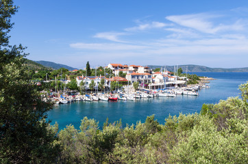 View to the picturesque little harbor of Steni Vala village, Alonnisos island, Greece Wall mural
