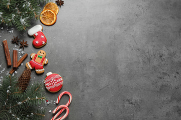 Fotobehang - Flat lay composition with tasty homemade Christmas cookies on grey table, space for text