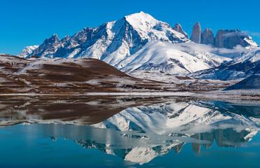 Foto auf Acrylglas Blau türkis Reflection of the Torres del Paine granite peaks in winter inside Torres del Paine National Park, Chile.