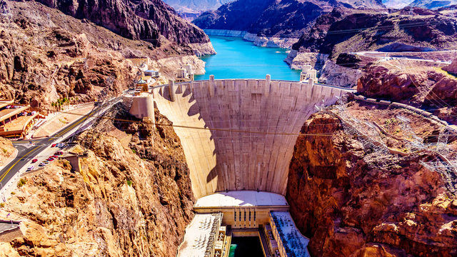 Frontal view of the Hoover Dam, a concrete arch dam in the Black Canyon of the Colorado River, on the border between Nevada and Arizona. Viewed from the Mike O'Callaghan–Pat Tillman Memorial Bridge