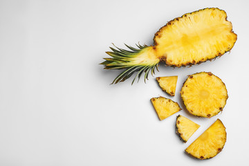 Composition with raw cut pineapple on white background, top view