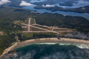 Fototapete - Aerial view of Long Beach Airport in Tofino during a vibrant summer morning. Located on the Pacific Coast in Vancouver Island, British Columbia, Canada.